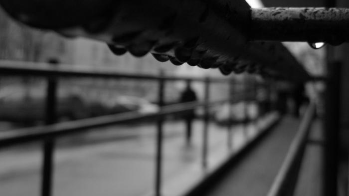 Raindrops under a handrail