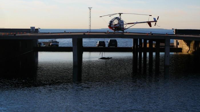 Helipad with a chopper near the sea