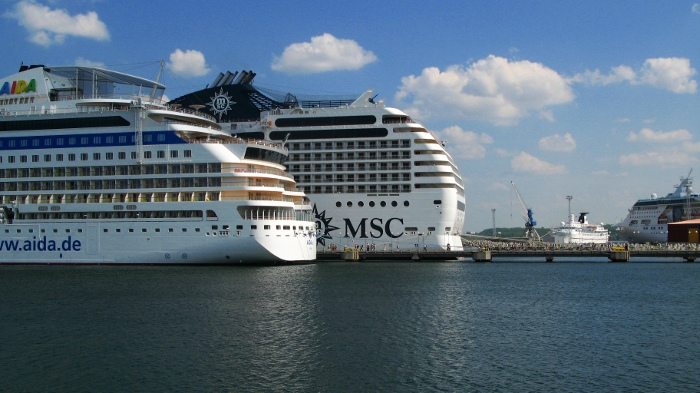 Sterns sides of two cruise ships